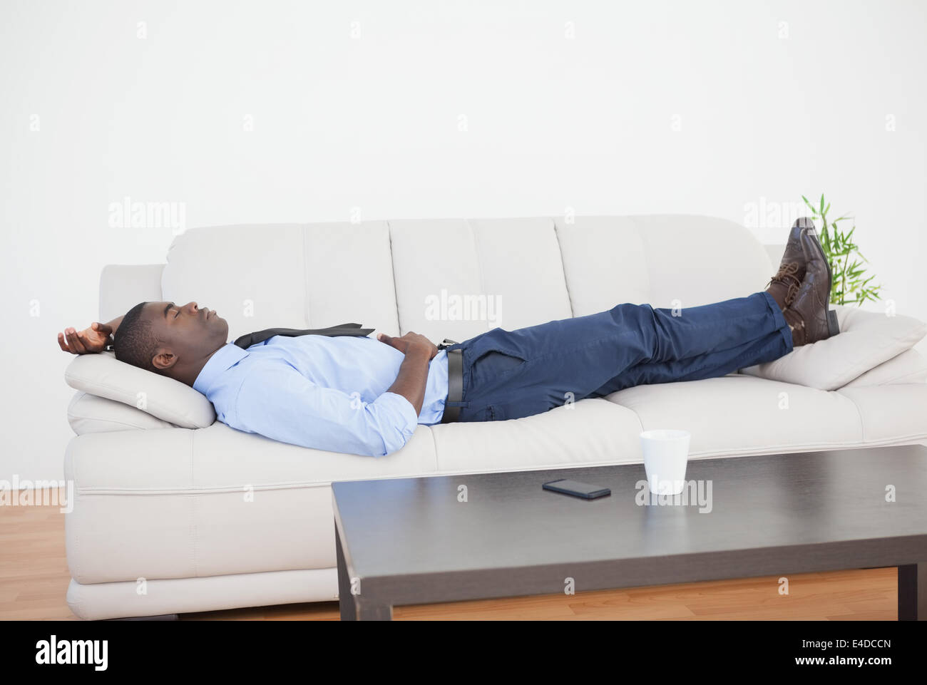 sleeping couch and sofa cape town baxton studio keeney dark gray linen modern bed tired businessman lying on the stock photo, royalty ...