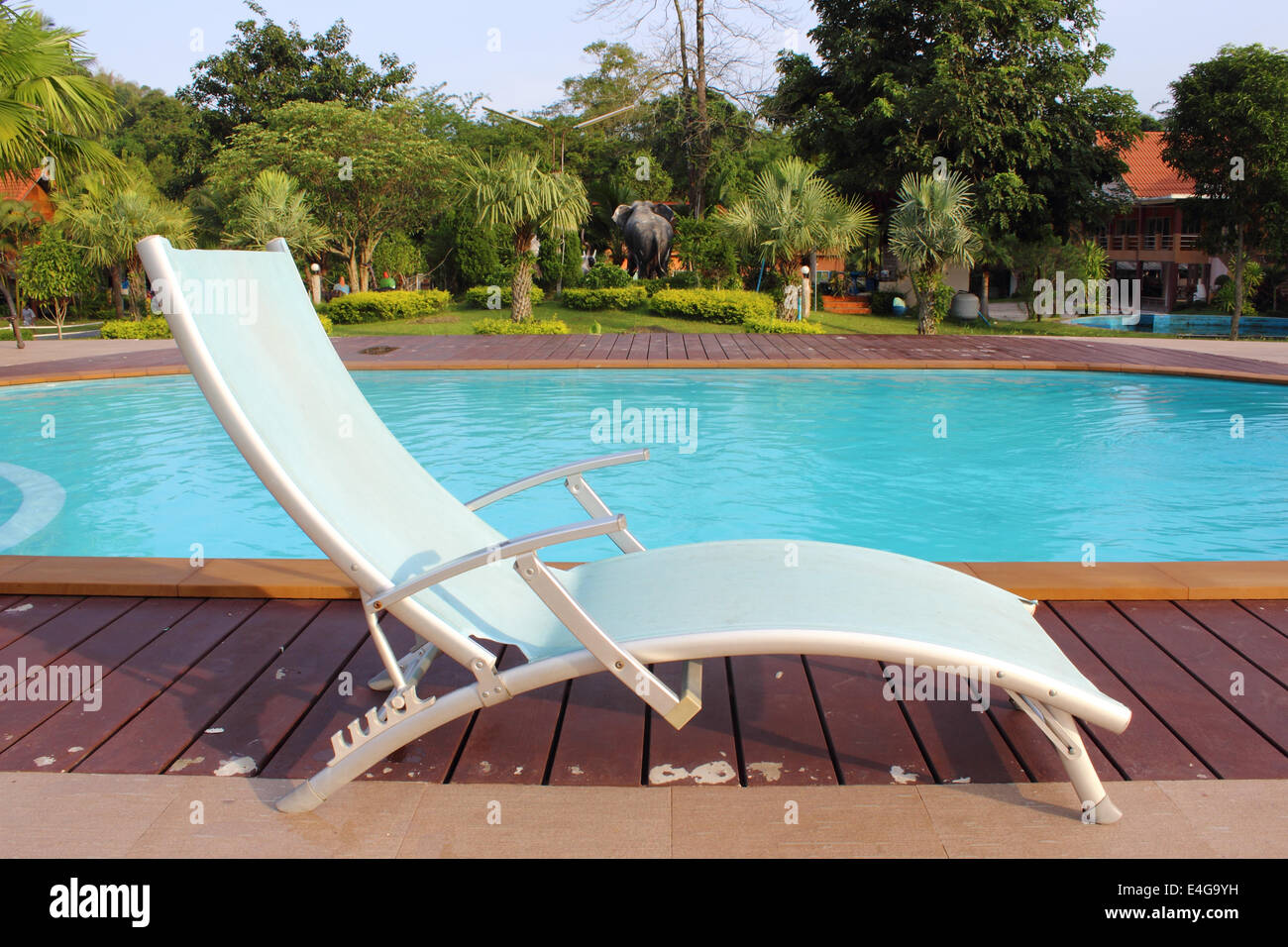 Chairs For Pool Lounge Chairs In A Swimming Pool Invite You To Relax Stock Photo