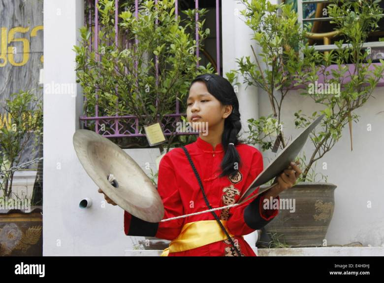 children playing music in traditional costumes during chinese new
