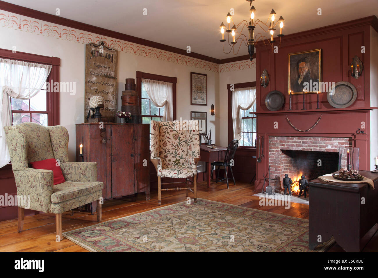 A formal living room with fireplace and two wing chairs