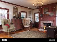 A formal living room with fireplace and two wing chairs ...