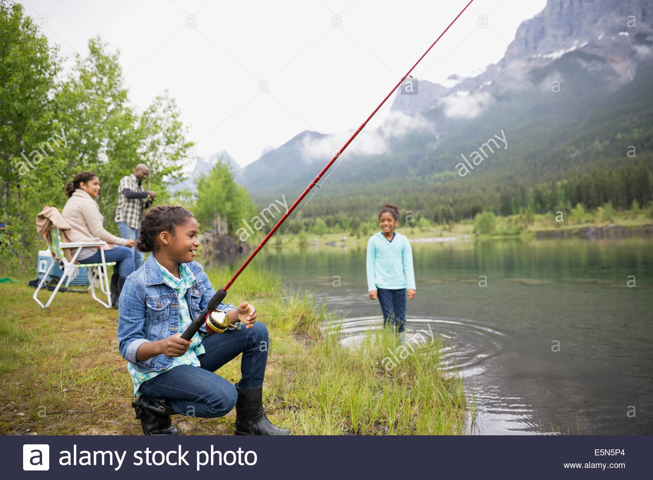 green fishing chair your zone flip available in multiple colors stock photos images alamy family at lakeside below mountains image