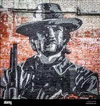 Street art, mural of a cowboy on a brick wall, Clarksdale ...