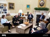 President Barack Obama convenes an Oval Office meeting ...