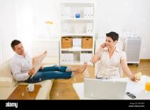 Couple Domestic Life Phone Living Room Stock