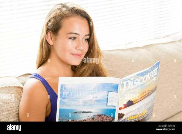 Young Woman Reading Holiday Vacation Brochure Stock
