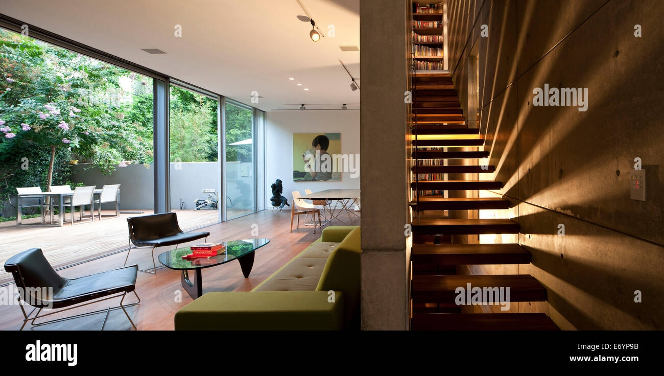 Open Plan Living Room And Staircase In S House Israel Middle | Stairs In Middle Of Room Interior Design | 3 Story Staircase | House | Middle Hallway | Private Home | Mixed Interior