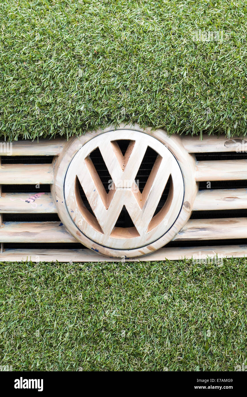 hight resolution of eco transporter van covered in astro turf and with wooden volkswagen badge and grill stock