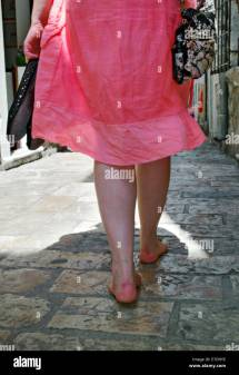 Girl Walking Barefoot Town