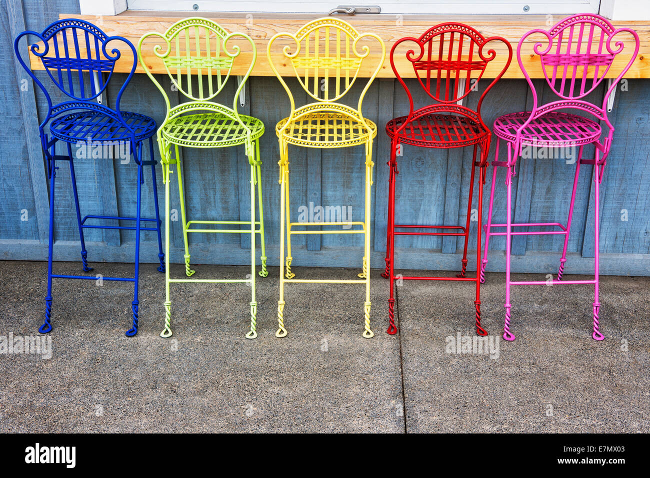 outdoor porch with colorful chairs