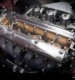 a 6 cylinder 3 litre jaguar e type classic sports car engine  [ 1300 x 1065 Pixel ]