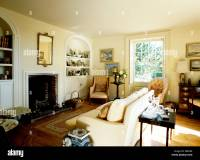 Alcove shelving on either side of fireplace in cream ...