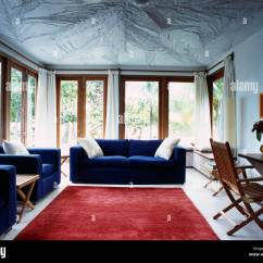 Red Rugs For Living Room Ashley Furniture Sets Prices Blue Sofas And Large Rug In Modern White Caribbean With Textured Ceiling