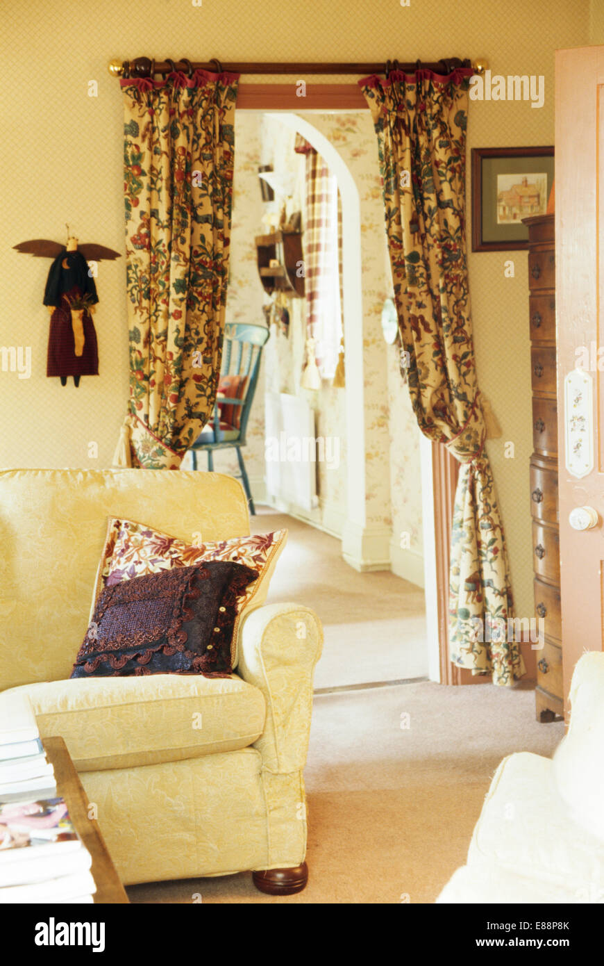 patterned curtains for living room decor with black leather couch cream sofa in cottage on doorway to small hall