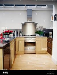 Stainless-steel extractor and splashback above oven in ...