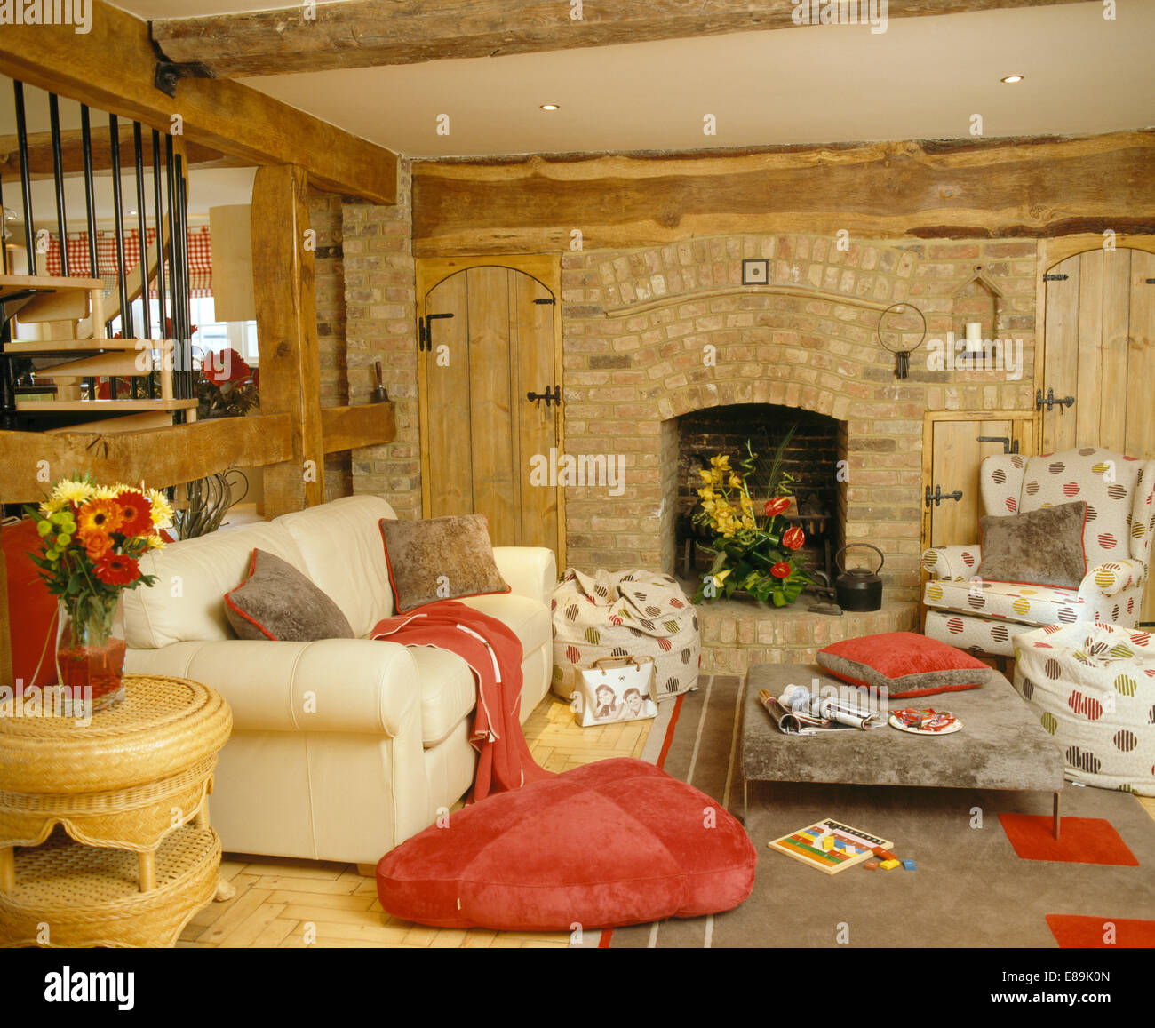 country living rooms with fireplaces feng shui for the room red floor cushion beside cream sofa in fireplace exposed brick wall