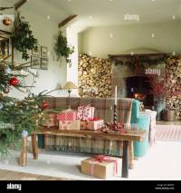 Christmas presents on rustic wooden bench behind sofa in ...
