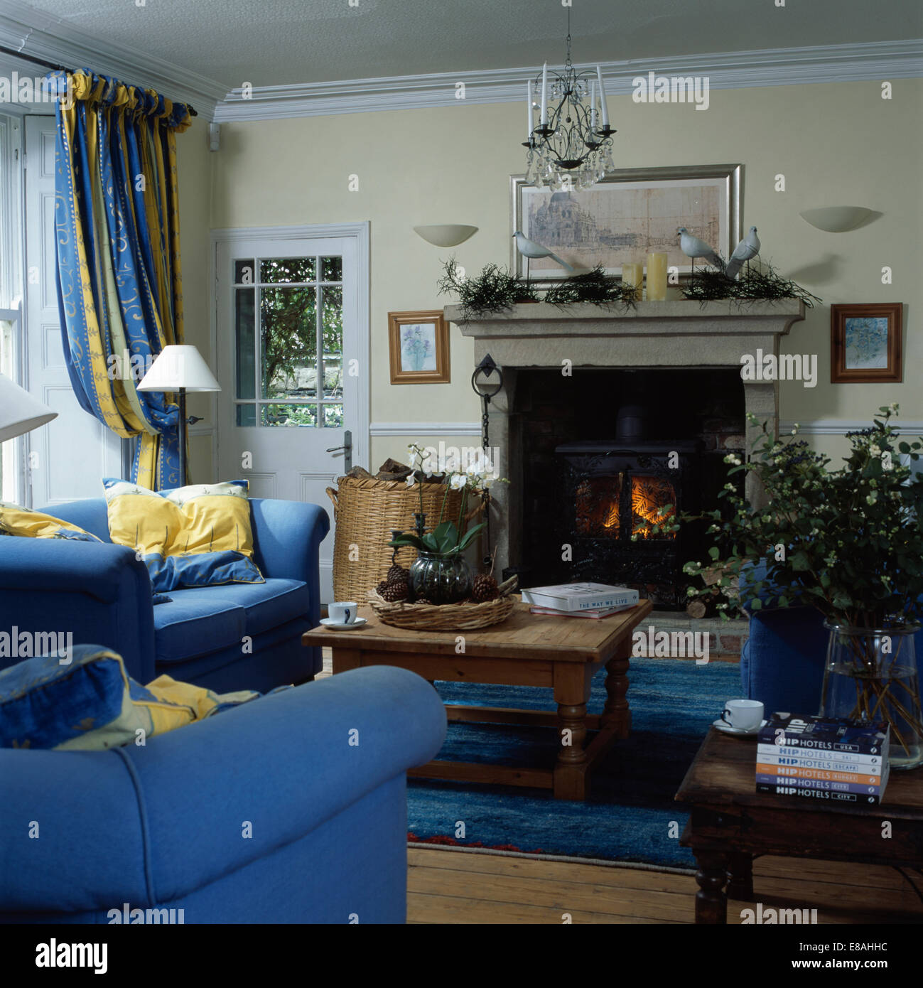country living rooms with fireplaces sectional room sets sale blue sofas in wood burning stove stone fireplace