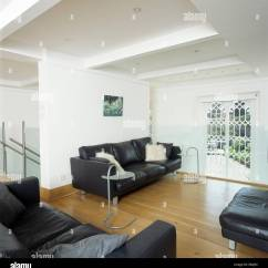 Living Rooms With Black Leather Sofas Room Carpet Ideas In Modern White Wooden Flooring And Gothic Style Window