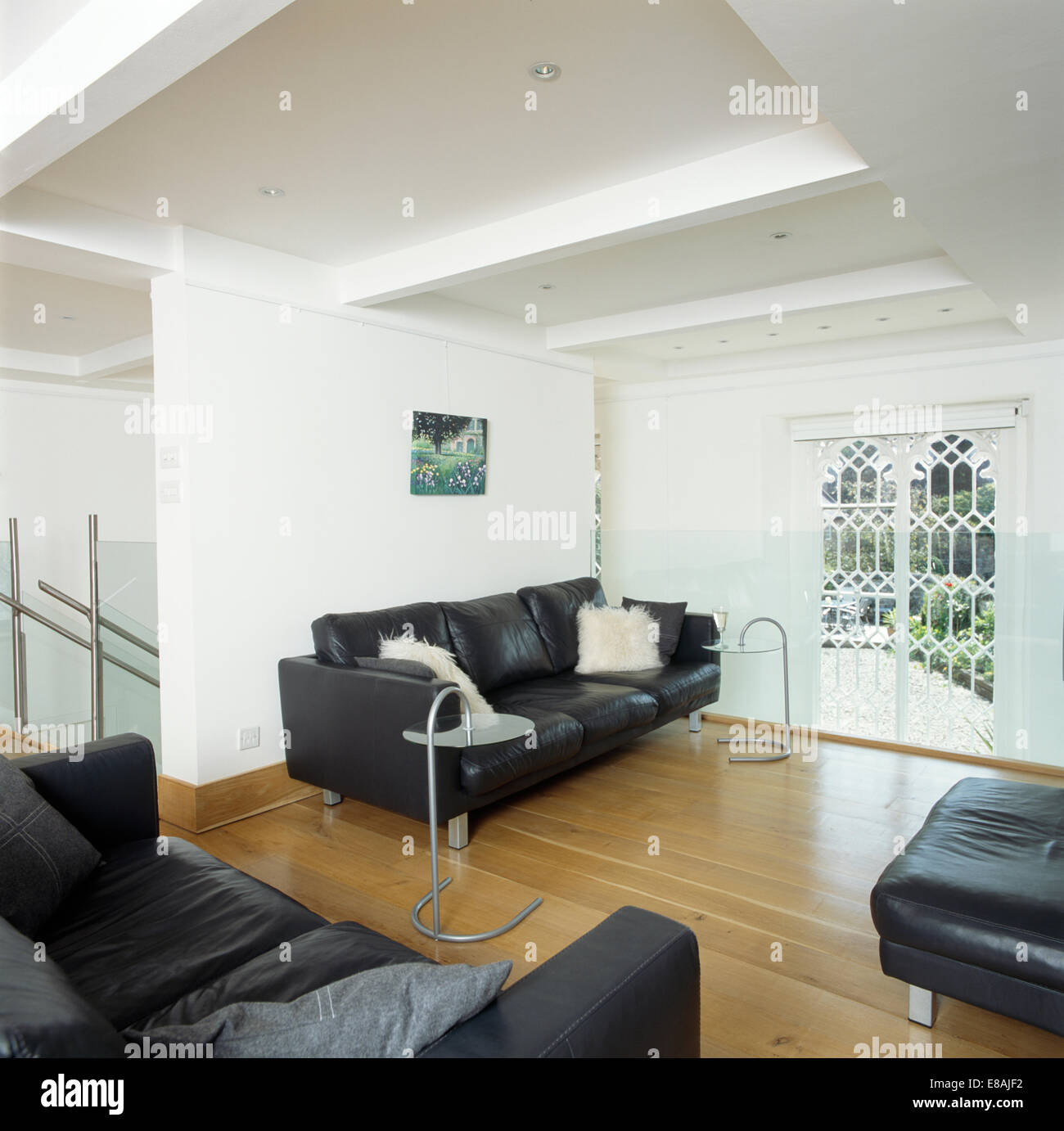contemporary living room with black leather sofa small layout ideas uk sofas in modern white wooden flooring and gothic style window