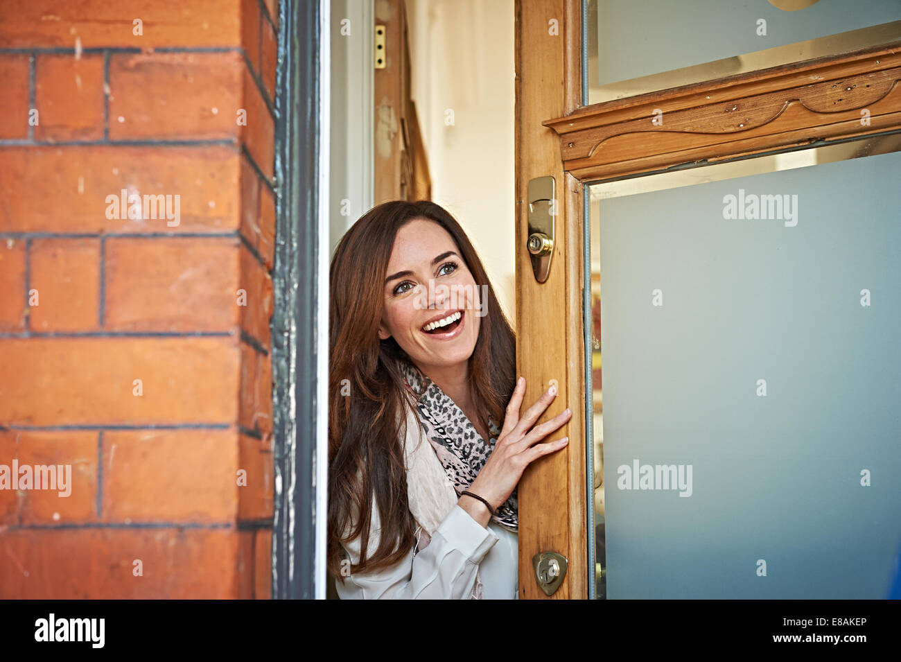 Woman opening front door Stock Photo, Royalty Free Image