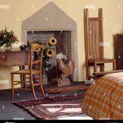 Unusual Wooden Chair Big Joe Bean Bag Tall Back Beside Simple Fireplace With Cockerel In Cottage Bedroom