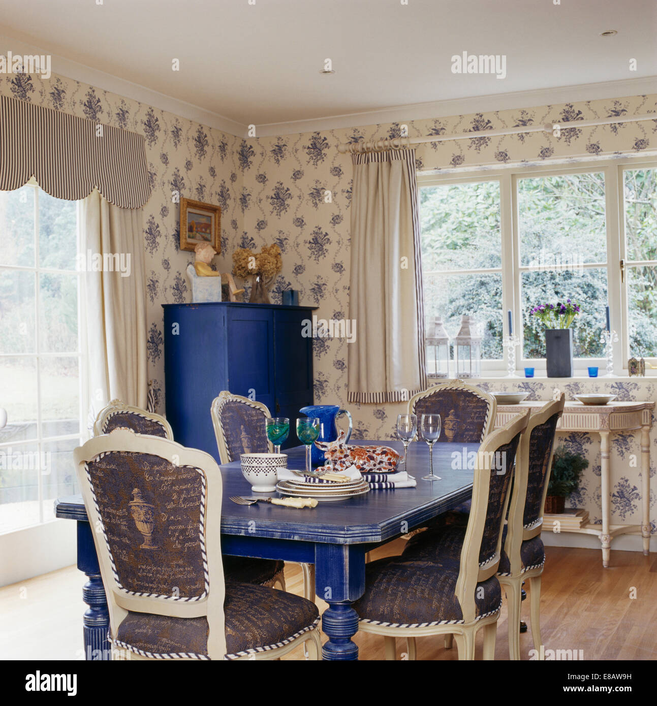 blue and white upholstered chairs stidd chair accessories painted table in country dining room with patterned wallpaper