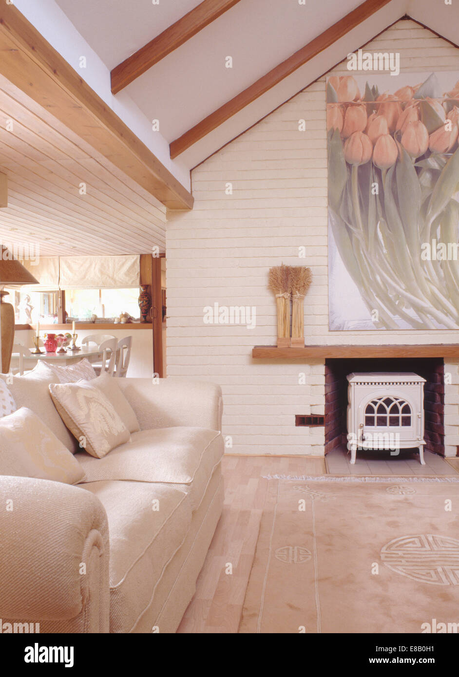Cream sofa in modern cottage living room extension with