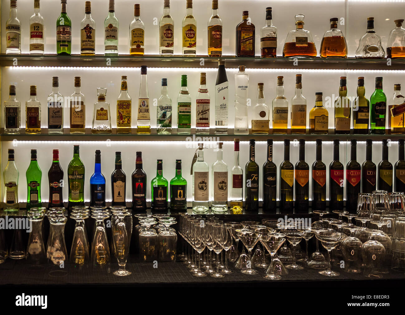 Bottles Of Wine Liquor And Spirits As Well As Glasses On A