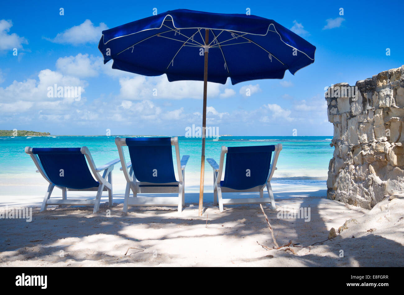 beach chairs and umbrella control room operator sun by sea long bay antigua stock caribbean