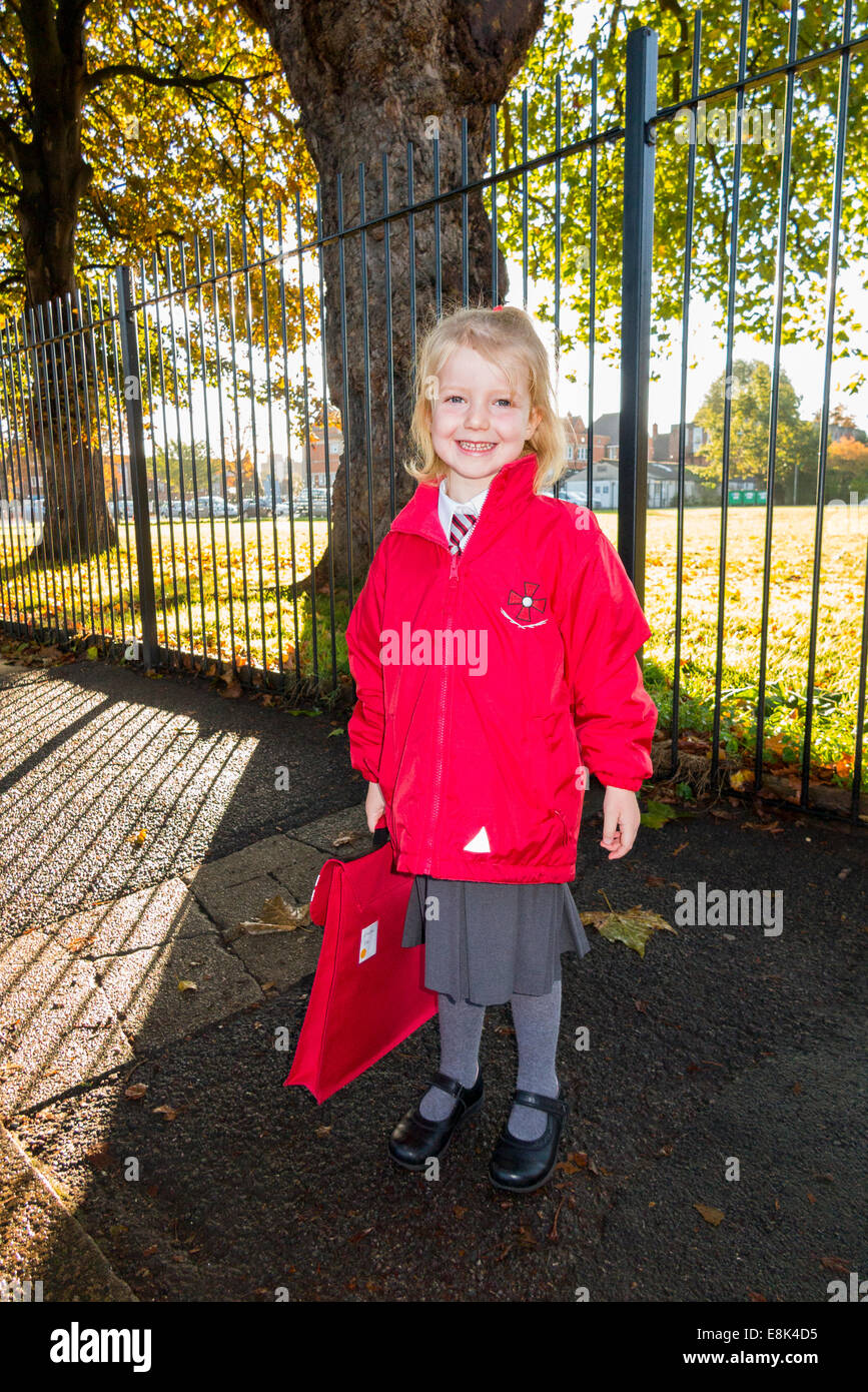 4 Year Old Child  Girl In Her New Red Uniform Going To