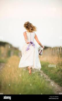 Girl Running Away Wedding Dress