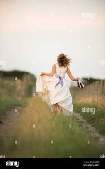 Girl Running in Wedding Dress