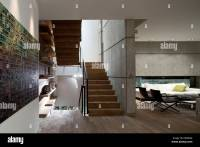 Open plan living room and staircase in D House, Israel ...