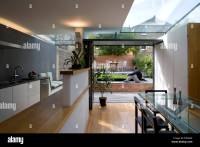 View from open plan kitchen and diner to garden in modern ...