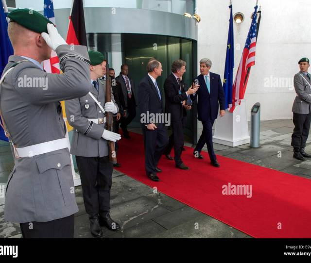 German National Security Adviser Christoph Heusgen Escorts U S Secretary Of State John Kerry And U S Ambassador To Germany John Emerson As They Leave The
