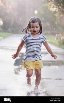 Girl Running through Puddle
