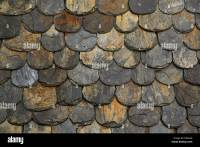Old slate roof tiles with rounded edges in close-up Stock ...