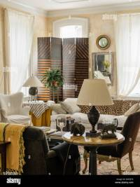 White muslin window drapes in living room with 4-segment ...