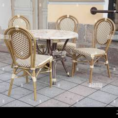 Parisian Cafe Table And Chairs Shower For Elderly In Paris Street Stock Photo 75418384 Alamy