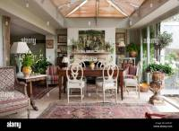 Roundback wooden dining chairs around antique farmhouse ...