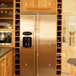 Kitchen Wine Rack Remodel Software Stainless Steel Fridge And Built In Storage With Wood Fitted Units