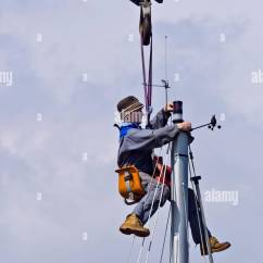Fishing Chair Crane How To Reupholster A Cushion Bosuns Stock Photos Images Alamy Workman Seated In Bosun S Suspended From Working At The Masthead Of Yacht