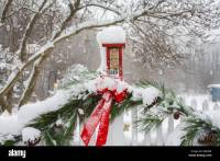 Winter Scene Of A Bird At A Red Christmas Decorations And