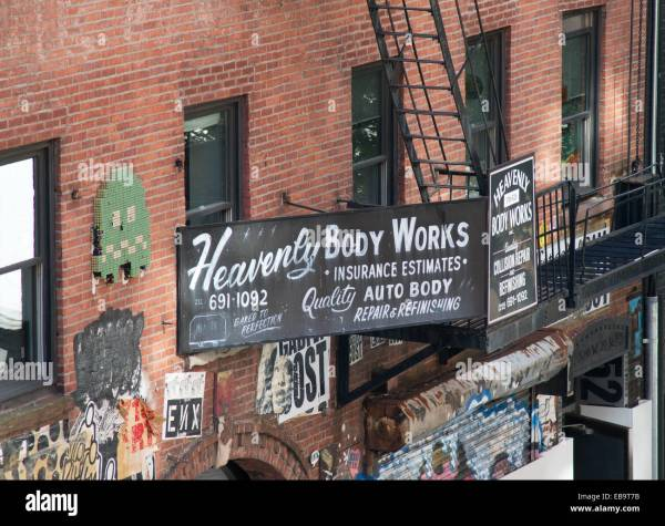 Sign Above Heavenly Body Works Auto Repair In