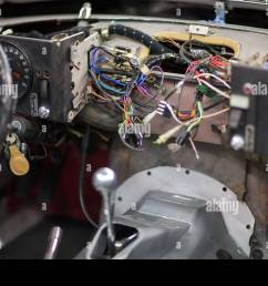 the dashboard wiring of a jaguar e type v12 at the repair shop of rh alamy com jaguar e type wiper motor wiring jaguar e type wiring diagram [ 1300 x 956 Pixel ]