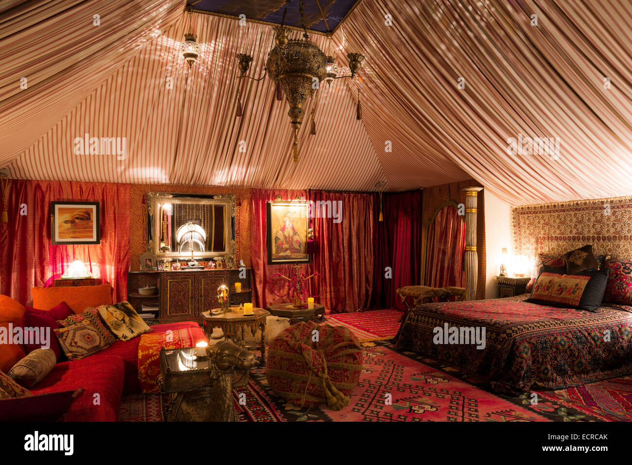Tent style boudoir bedroom with Moroccan rugs oriental
