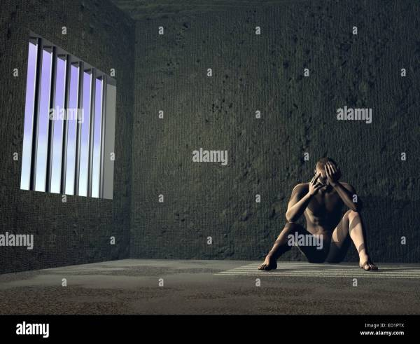 Sad Man Sitting In Jail Window With Bars