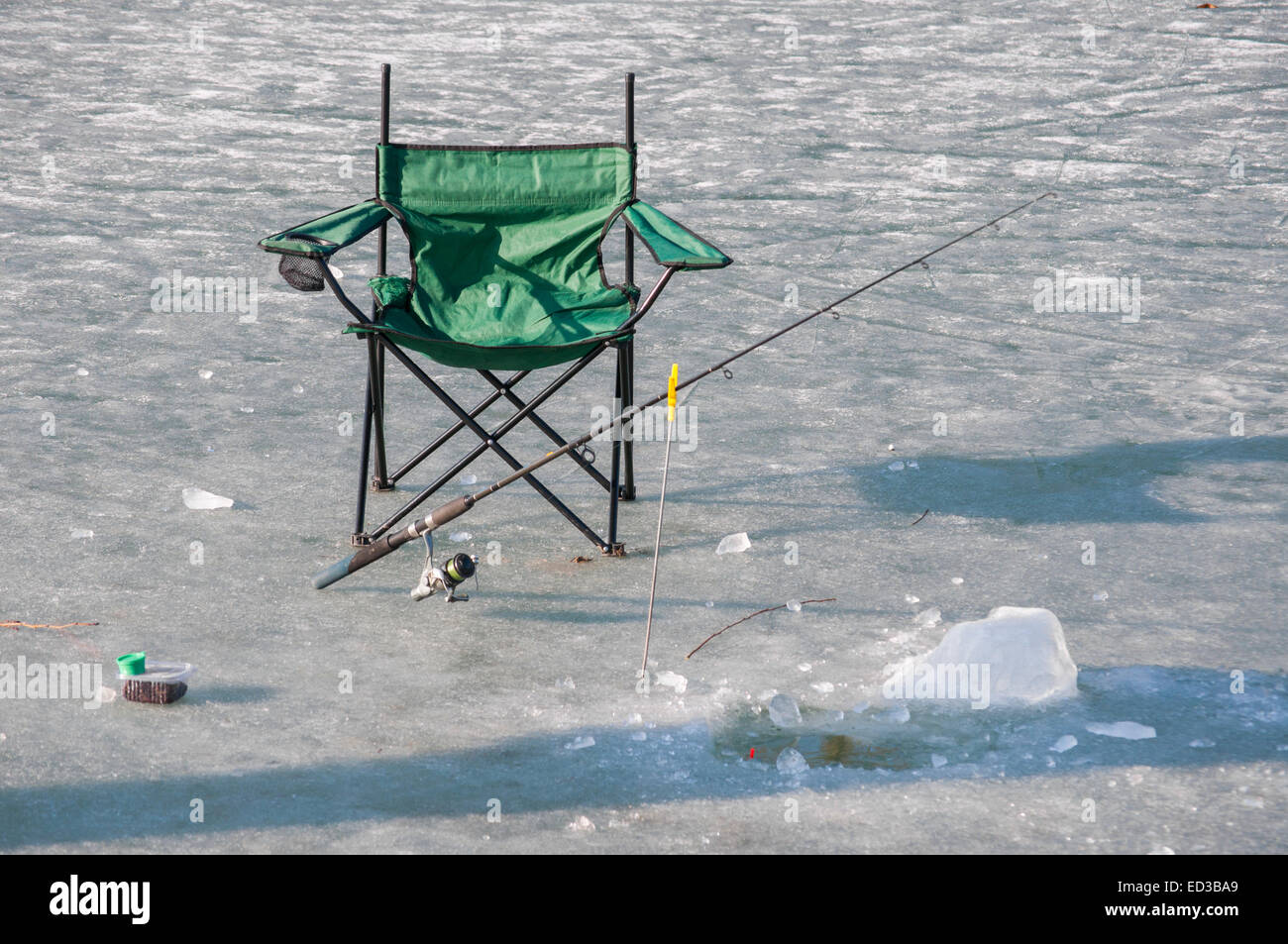 fishing chair setup tennis court umpire chairs hole stock photos images picture of a fisher prepared for catching fish under ice sheet image