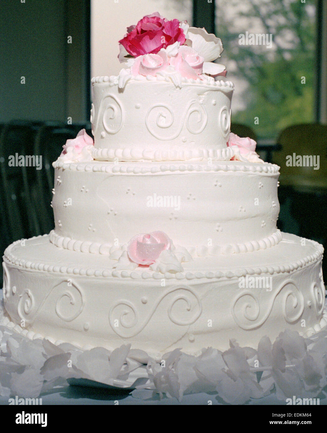 A 3 Tier White Wedding Cake With Pink Roses Stock Photo 77264940